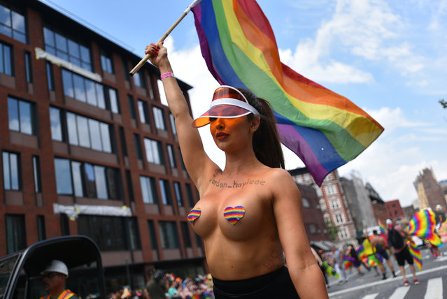 People attend the 49th annual New York City Gay Pride Parade in New York, New York, USA on 24 June 2018. (Photo by Erik Pendzich/Rex Features/Shutterstock)