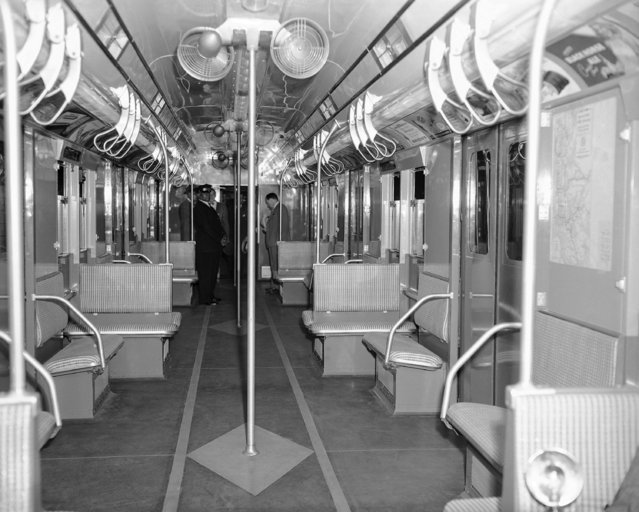 Interior view of the subway car of the future as it was displayed at the Chambers Street Station of the Independent Division in New York on July 9, 1947. The new car has 56 seats, 14 adjustable, exhaust ventilators, eight 10-inch fans, is painted blue and grey and has an off-white ceiling. (Photo by Anthony Camerano/AP Photo)