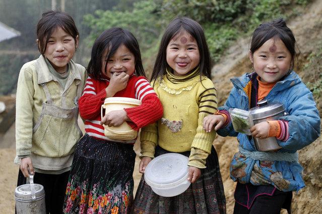 """Kids of Sapa"". Four little beautiful Hmong girls from Lao Chai Village, near Sapa, Vietnam. (Photo and caption by Felipe Hanower/National Geographic Traveler Photo Contest)"