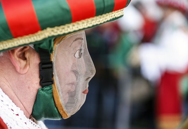 A man wearing a traditional mask and costume takes part in the Schleicherlaufen festival in the western Austrian town of Telfs February 1, 2015. (Photo by Dominic Ebenbichler/Reuters)