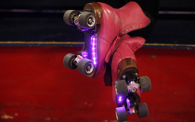 A woman wears roller skates with lights on the bottom at Rich City Skate in Richton Park, Illinois, January 12, 2015. (Photo by Jim Young/Reuters)