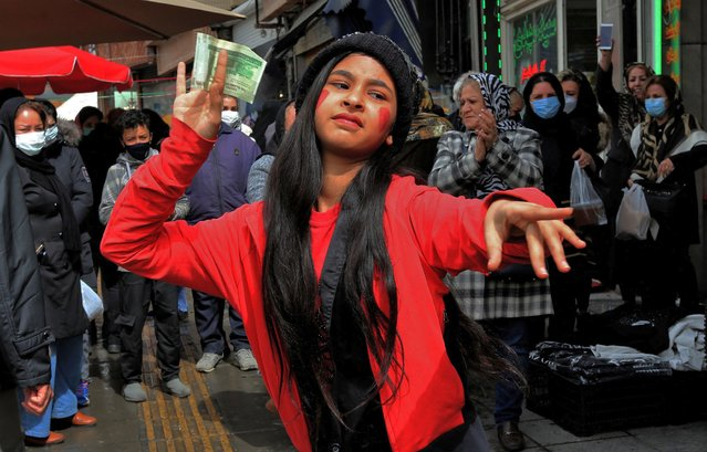 "An Iranian girl wearing a costume inspired in the fictional folklore character Hajji Firuz, dances in Tehran on March 17, 2021 as Iranians prepare to celebrate Noruz, the Iranian New Year. Noruz, ""new day"" in Persian, is the New Year festivity celebrated in Iran as well as in Afghanistan and Kurdish regions in several countries. It begins with the spring equinox and symbolises rebirth. (Photo by Atta Kenare/AFP Photo)"