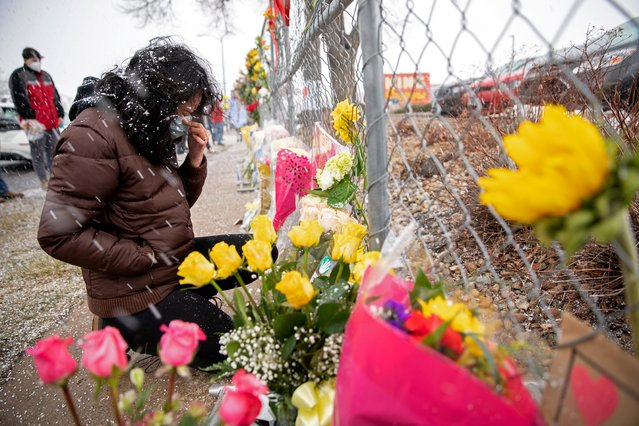 Stephanie Kaiser becomes emotional as she places flowers at the site of a mass shooting at King Soopers grocery store in Boulder, Colorado, U.S. March 23, 2021. (Photo by Alyson McClaran/Reuters)