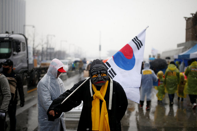 A man in costume attends a protest calling for Park Geun-hye to step down as it snows in Central Seoul, South Korea, November 26, 2016. (Photo by Kim Kyung-Hoon/Reuters)