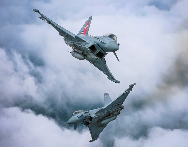 """Perfection"". Image of the year, third prize: A pair of Typhoon FGR4 aircraft perform a dynamic crossover on their arrival at the RAF Cosford air show. (Photo bu Sgt Paul Oldfield/RAF)"