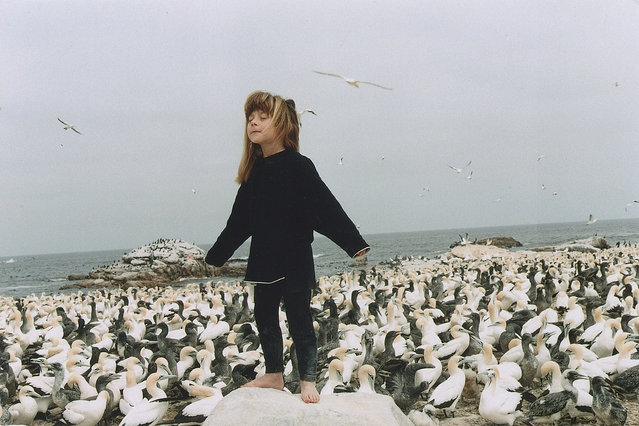 Tippi aged 6 with her arms stretched out on Sea Bird Island, Africa, 1996. (Photo by Sylvie Robert/Barcroft Media)