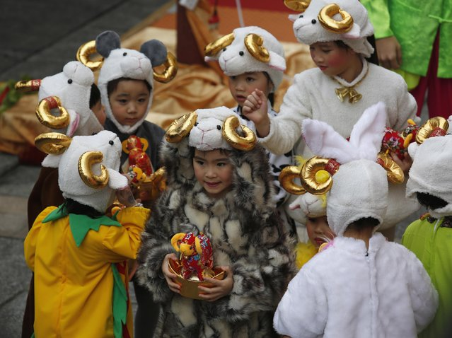 Young performers wearing goat hats take part in a Chinese New Year celebration at a shopping mall in Hong Kong February 23, 2015. (Photo by Bobby Yip/Reuters)