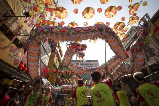 A dragon dance is performed at China Town on the last day of the Chinese Lunar New Year celerations in Kuala Lumpur, Malaysia, Thursday, March 5, 2015. (AP Photo/Vincent Thian)