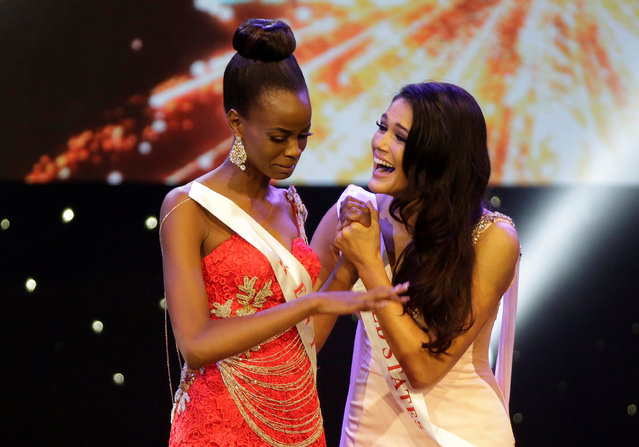 Miss Kenya Evelyn Njambi Thungu (L) is congratulated by Miss United States Audra Mari after Thungu was named a finalist in the Miss World 2016 Competition in Oxen Hill, Maryland, U.S., December 18, 2016. (Photo by Joshua Roberts/Reuters)