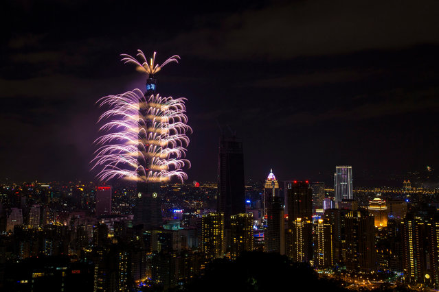 Fireworks and light effects illuminate the night sky from the Taipei 101 skyscraper during New Year's Eve celebrations in Taipei, Taiwan, 01 January 2017. This year's cross-year celebration for the first time uses fireworks combined with light show displaying special effects around the building.An estimated cost of the show is around 45 million Taiwan dollars (1.4 million US Dollars). (Photo by Ritchie B. Tongo/EPA)