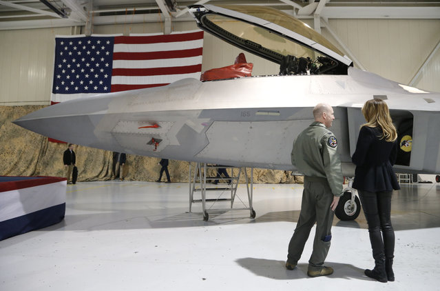 First lady Melania Trump, right, talks with Col. Jason Hinds, Commander of the First Fighter Wing as he shows her the cockpit of an F22 fighter at Joint Base Langley in Hampton, Va., Wednesday, December 12, 2018. (Photo by Steve Helber/AP Photo)