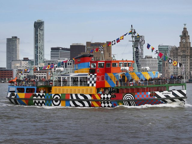 The newly painted Snowdrop travels on the River Mersey to Liverpool on April 2, 2015 seen from Birkenhead, England. The Mersey ferry has been re-painted in a dazzle camouflage design by Beatles album cover creator Sir Peter Blake. The colourful design mimics the type of paint scheme applied to allied shipping during World War One to confuse the enemy. (Photo by Peter Macdiarmid/Getty Images)