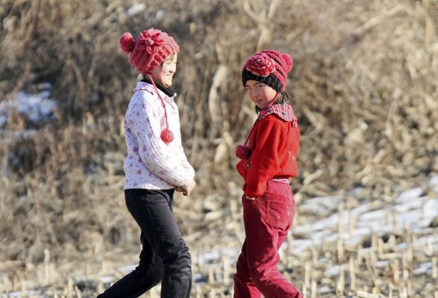 North Korean girls walk along an alley  on the banks of Yalu River, in Sakchu county, North Korea, January 7, 2016. (Photo by Jacky Chen/Reuters)