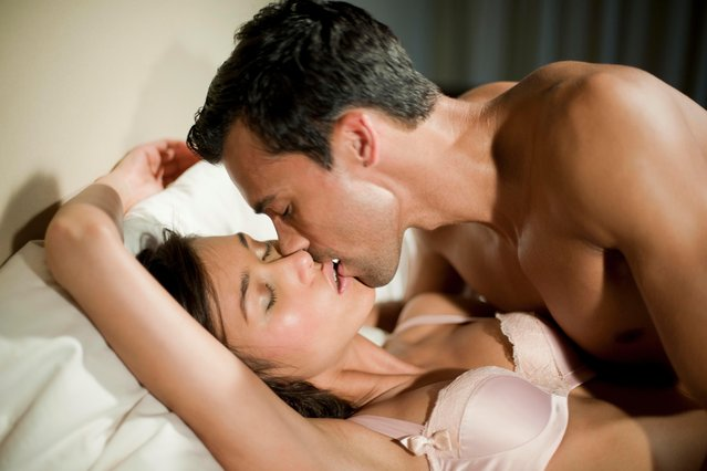 Couple embracing In the bedroom. (Photo by isitsharp/Getty Images)