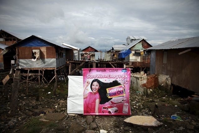 A poster advertising SunSilk shampoo is seen in Tacloban, Philippines city in this October 15, 2014 file photo. Unilever is expected to release Q1 results this week. (Photo by Thin Lei Win/Reuters)