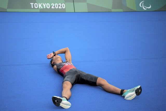Hideki Uda, from Japan, reacts at the ground after winning the silver medal in the Men's Triathlon PTS4 at the Odaiba Marine Park at the 2020 Paralympics in Tokyo, Saturday, August 28, 2021. (Photo by Joel Marklund/OIS/AP Photo)