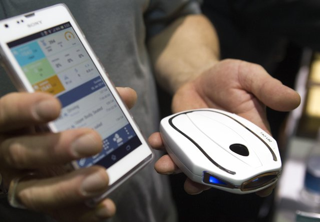 "A Tao WellShell is displayed during ""CES Unveiled"", a media preview event to the annual Consumer Electronics Show (CES), in Las Vegas, Nevada, January 5, 2014. The WellShell is an electronic isometric device but also monitors various fitness levels and transmits the data to a smartphone. (Photoby Steve Marcus/Reuters)"
