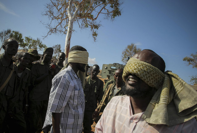 In 2008 the U.S. designated al Shabaab a foreign terrorist organization. Caption: Men suspected to be from al Shabaab are guarded at a former police station by soldiers of the Somali National Army (SNA) as engineers serving with the Kenyan Contingent of the African Union Mission in Somalia (AMISOM) searched the premises for improvised explosive devices (IEDs) in the southern Somali port city of Kismayu, October 3, 201. (Photo by Stuart Price/Reuters/African Union-United Nations Information Support Team)