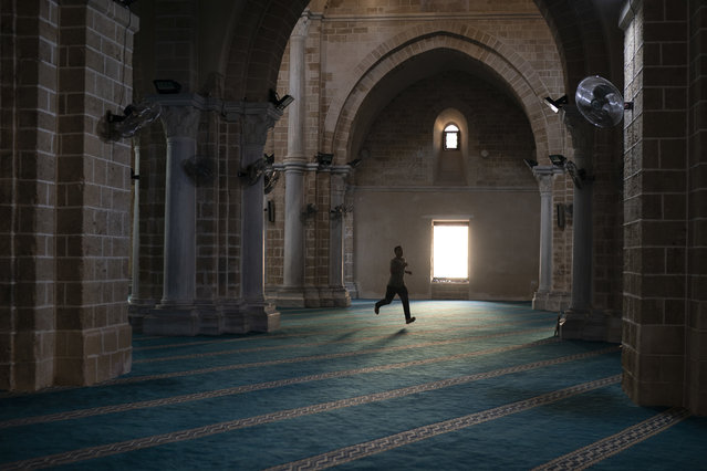 A man runs as he arrives a few minutes late for the afternoon prayer in a mosque in Gaza City, Friday, September 14, 2018. (Photo by Felipe Dana/AP Photo)