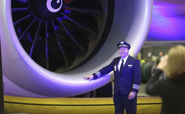 Captain Fergie Ferguson poses for a personal snap shot with an engine of American Airlines' first Boeing 787 Dreamliner at the airline's maintenance hangar at Dallas-Fort Worth International Airport, Wednesday, April 29, 2015, in Grapevine, Texas. (Photo by L. M. Otero/AP Photo)