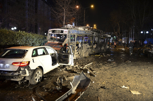 Damaged vehicles are seen at the scene of an explosion in Ankara, Turkey, Sunday, March 13, 2016. (Photo by Selahattin Sonmez/Hurriyet Daily via AP Photo)