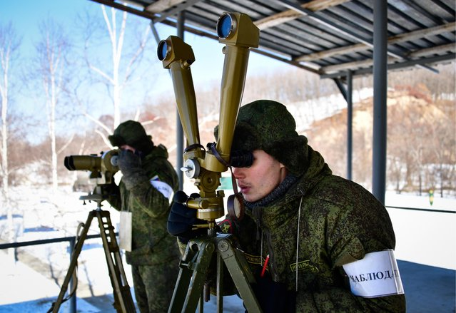 Artillery observer during military exercises conducted by the Russian Pacific Fleet' s naval infantry unit at the Bamburovo firing range on February 2, 2017. (Photo by Yuri Smityuk/TASS)