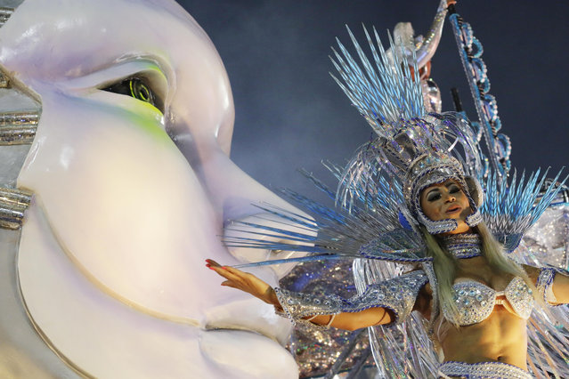 A performer from the Beija Flor samba school parades during carnival celebrations at the Sambadrome in Rio de Janeiro, Brazil, Monday, March 3, 2014. (Photo by Nelson Antoine/AP Photo)