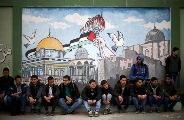 Palestinian students sit in front of a mural as they watch a military-style show at a school in Rafah in the southern Gaza Strip March 28, 2016. (Photo by Ibraheem Abu Mustafa/Reuters)