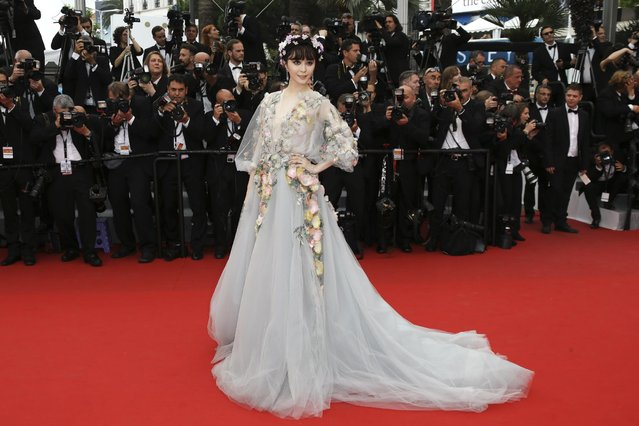 """Actress Fan Bing Bing poses for photographers as she arrives for the screening of the film """"Mad Max: Fury Road"""" at the 68th international film festival, Cannes, southern France, Thursday, May 14, 2015. (Photo by Joel Ryan/Invision/AP Photo)"""