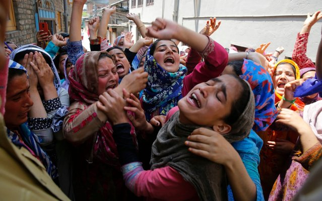 Female Kashmiri Muslim protester wail and shout slogans as police try to stop their protest march on the outskirts of Srinagar, the summer capital of Indian Kashmir, 13 May 2019. Protests erupted at several places on the second consecutive day in Indian Kashmir against the alleged rape of a three-year-old girl by a local boy at Malikpora, Trehgam area of Sumbal in north Kashmir's Bandiporoa district on 08 May 2019. The protesters were demanding exemplary punishment to the accused who has been arrested by police. (Photo by Farooq Khan/EPA/EFE/Rex Features/Shutterstock)