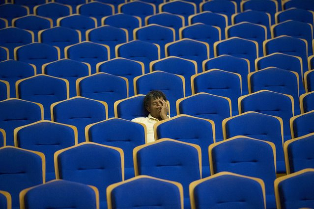 A man takes a nap during a rehearsal of the Minnesota Orchestra in Havana, May 15, 2015. (Photo by Alexandre Meneghini/Reuters)