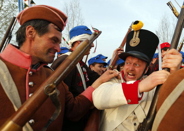 People dressed as Hungarian Hussars and Austrian soldiers of the Habsburg dynasty take part in the re-enactment of the battle of Tapiobicske, Hungary April 4, 2016. (Photo by Laszlo Balogh/Reuters)