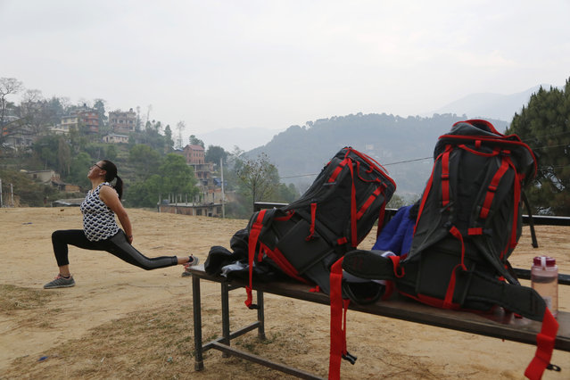 In this photo taken Saturday, March 30, 2019, Furdiki Sherpa, 43, performs morning exercises as she trains to summit Mount Everest, in Kathmandu, Nepal. Five years after one of the deadliest disasters on Mount Everest, three people from Nepal's ethnic Sherpa community, including Sherpa, are preparing an ascent to raise awareness about the Nepalese mountain guides who make it possible for hundreds of foreign climbers to scale the mountain and survive. Sherpa lost her husband in the 2014 ice avalanche on Everest's western shoulder that killed 16 fellow Sherpa guides. (Photo by Niranjan Shrestha/AP Photo)