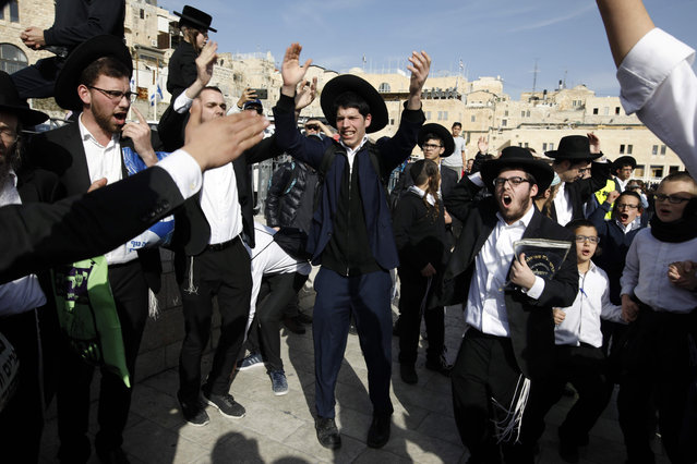 Ultra- Orthodox Jewish men shout slogans during a demonstrationg against the liberal Jewish religious group Women of the Wall, on February 27, 2018, during a prayer service at the Western Wall plaza, in the Old city of Jerusalem. (Photo by Menahem Kahana/AFP Photo)