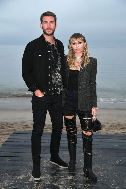 (L-R) Liam Hemsworth and Miley Cyrus attend the Saint Laurent Mens Spring Summer 20 Show on June 06, 2019 in Paradise Cove Malibu, California. (Photo by Neilson Barnard/Getty Images)