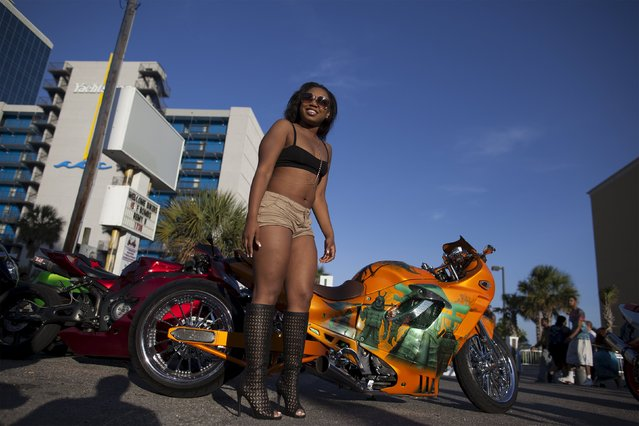 "Sierra ""Lovely Amazin"" Redd of Greensboro, North Carolina, poses for bikers by a custom Suzuki Katana on Ocean Boulevard during the 2015 Atlantic Beach Memorial Day BikeFest in Myrtle Beach, South Carolina May 24, 2015. (Photo by Randall Hill/Reuters)"