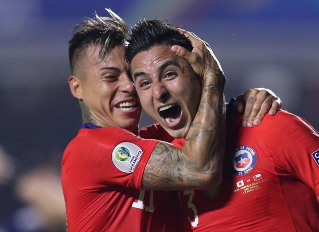Chile's Erick Pulgar (R) celebrates with teammate Chile's Eduardo Vargas after scoring during a Copa America football tournament Group C match between Chile and Japan at the Cicero Pompeu de Toledo Stadium, also known as Morumbi, in Sao Paulo, Brazil, on June 17, 2019. (Photo by Ueslei Marcelino/Reuters)