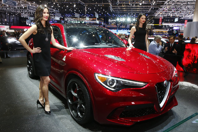 Models pose next to the new Alfa Romeo Stelvio during the 87th International Motor Show at Palexpo in Geneva, Switzerland March 7, 2017. (Photo by Arnd Wiegmann/Reuters)