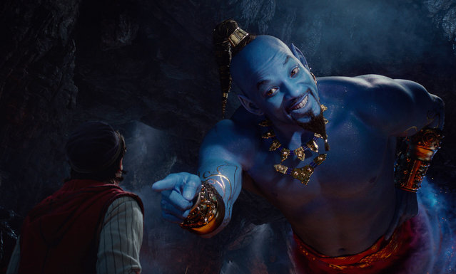 "This image released by Disney shows Mena Massoud as Aladdin, left, and Will Smith as Genie in Disney's live-action adaptation of the 1992 animated classic  ""Aladdin"". (Photo by Disney via AP Photo)"