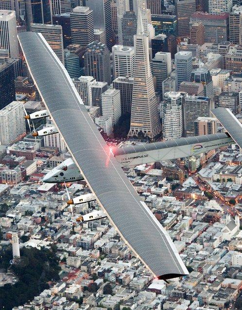 Solar Impulse 2 flies over San Francisco before landing at Moffett Field on Saturday, April 23, 2016. (Photo by Noah Berger/AP Photo)