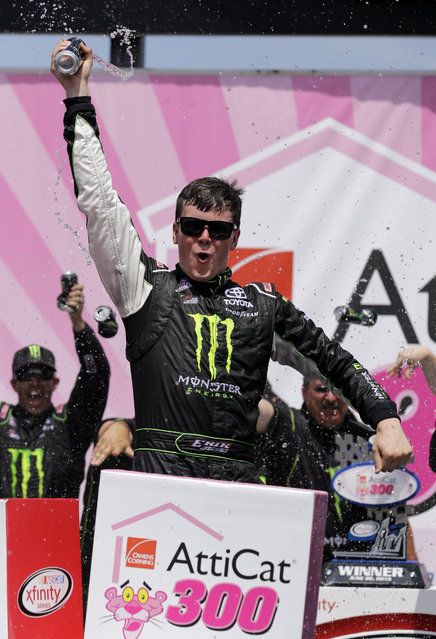 Erik Jones celebrates with his crew in Victory Lane after winning the NASCAR Xfinity series auto race at Chicagoland Speedway, Sunday, June 21, 2015, in Joliet, Ill. (AP Photo/Nam Y. Huh)