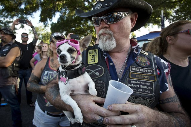 "Dennis Leasure holds his dog Dixie Poo as they listen to instructions for a ""Ride for Pride"" event to show their support for the Confederate flag in Brandon, Hillsborough County, June 26, 2015. (Photo by Carlo Allegri/Reuters)"