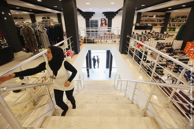 A worker walks through the new Maximall clothing store