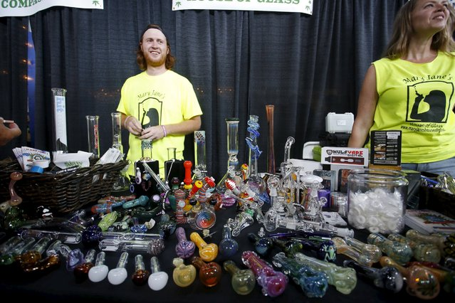 """Vendors and marijuana enthusiasts gather at the """"Weed the People"""" event to celebrate the legalization of the recreational use of marijuana in Portland, Oregon July 3, 2015. Smoking marijuana became legal in Oregon on July 1, fulfilling the first step in a voter-approved initiative that will usher in a network of legal weed retail stores in 2016, similar to the systems already operating in neighboring Washington state and Colorado. (Photo by Steve Dipaola/Reuters)"""