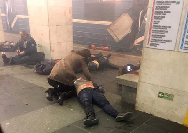 Blast victims lie near a subway train hit by a explosion at the Tekhnologichesky Institut subway station in St.Petersburg, Russia, Monday, April 3, 2017. (Photo by AP Photo/www.vk.com/spb_today via AP Photo)
