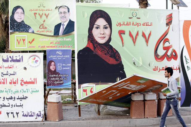 A man walks past election posters of Iraqi women candidates in Baghdad, April 24, 2014.  As Iraq's general election draws closer, both men and women are vying for seats in the country's parliament. But this year's election, the first one after the withdrawal of U.S troops in 2011, has seen an increase in the number of female candidates. (Photo by Thaier al-Sudani/Reuters)