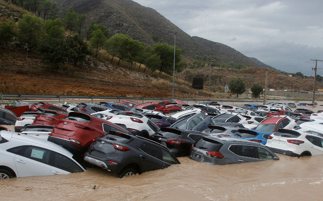 """Cars submerged in water after the strong rain know as the """"gota fria"""" (cold drop) that hit Orihuela, Alicante, eastern Spain, 12 September 2019. The """"gota fria"""" phenomenon is affecting the Mediterranean coast with strong winds and rainfalls of 100 liters per square meter affecting especially Valencia and Murcia. Murcia's regional Government ordered the closure of schools in the region. (Photo by EPA/EFE/MORELL)"""