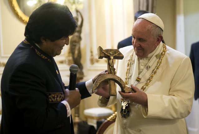 Pope Francis receives a gift from Bolivian President Evo Morales (L) in La Paz, Bolivia, July 8, 2015. (Photo by Osservatore Romano/Reuters)