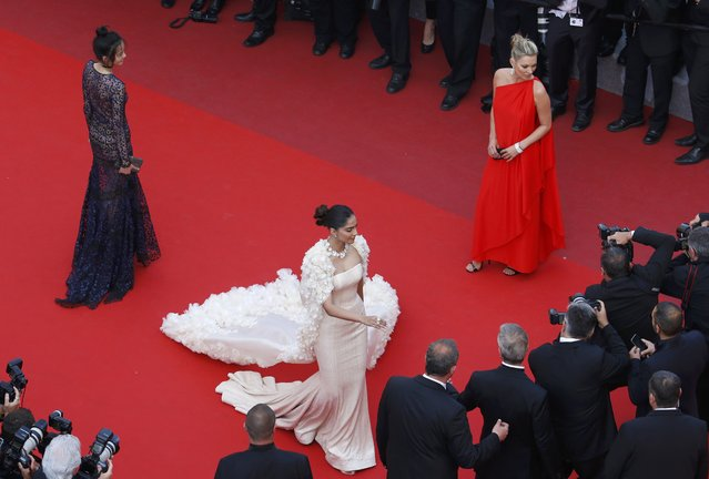 """Model Xiao Wen Ju, Actress Sonam Kapoor and model Kate Moss pose on the red carpet as they arrive for the screening of film """"Loving"""" in competition at the 69th Cannes Film Festival in Cannes, France, May 16, 2016. (Photo by Yves Herman/Reuters)"""