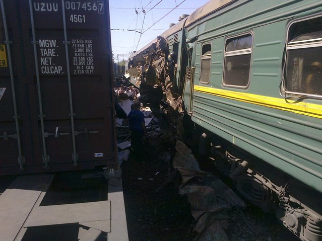 A view shows a passenger train damaged in a collision with a freight train in Moscow region in this May 20, 2014 handout photo provided by Russian Emergencies Ministry. Two trains collided near Moscow on Tuesday, causing casualties, Russia's Emergencies Ministry said. Itar-Tass news agency said the collision was between a freight train and a passenger train. Media reports of deaths could not immediately be confirmed. (Photo by Reuters/Press Service of Russian Emergencies Ministry of Moscow Region)
